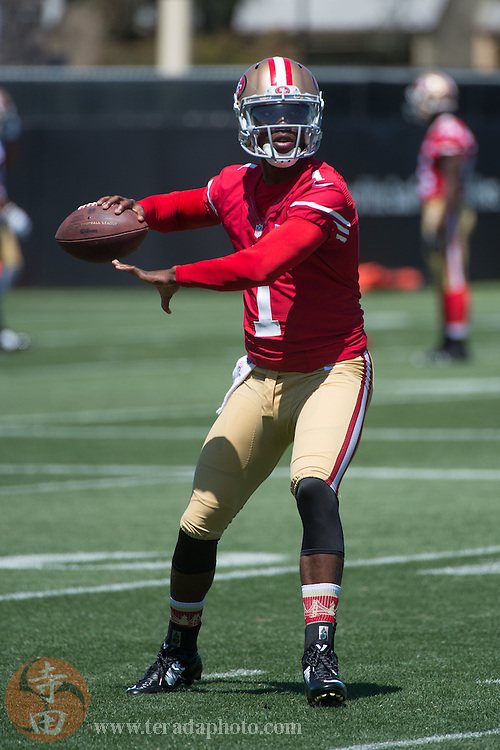 July 24, 2014; Santa Clara, CA, USA; San Francisco 49ers quarterback Josh Johnson (1) throws the football during training camp at the SAP Performance Facility.