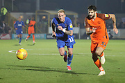 AFC Wimbledon midfielder Mitchell (Mitch) Pinnock (11) in a foot race with Southend United defender Stephen Hendrie (32) during the EFL Sky Bet League 1 match between AFC Wimbledon and Southend United at the Cherry Red Records Stadium, Kingston, England on 24 November 2018.