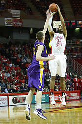 29 December 2011: Jackie Carmichael lines up a shot as Seth Tuttle challenges  during an NCAA mens basketball game between the Northern Illinois Panthers and the Illinois State Redbirds in Redbird Arena, Normal IL