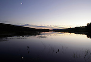 Mamakating, New York - Clouds and the crescent moon are reflected in the water of the Bashakill Wildlife Management Area on Oct. 12, 2010.
