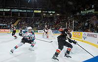 KELOWNA, CANADA - FEBRUARY 28: Leon Draisaitl #29 of Kelowna Rockets skates for the puck against the Calgary Hitmen on February 28, 2015 at Prospera Place in Kelowna, British Columbia, Canada.  (Photo by Marissa Baecker/Shoot the Breeze)  *** Local Caption *** Leon Draisaitl;