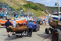 Ferriby Ships, the half scale replica Bronze Age Boat attracts interest at the RNLI open day, Filey East Yorkshire coast, Saturday 15 August 2009.