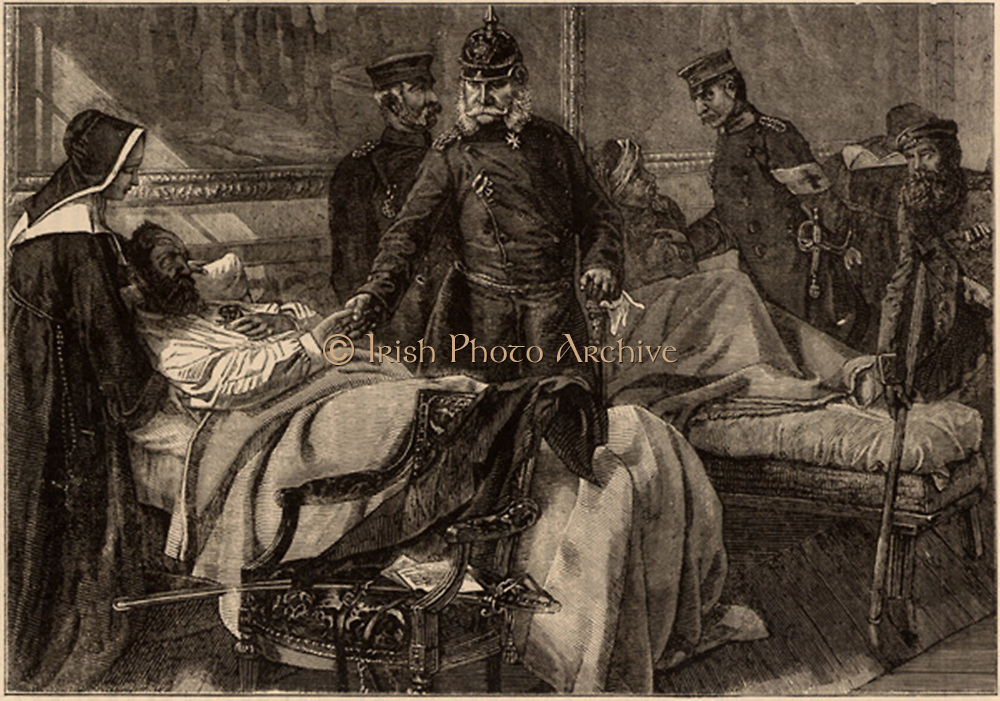 Franco-Prussian War 1870-1871: Wilhelm I (1797-1788) king of Prussia and first Emperor of Germany, visiting wounded German troops being nursed  in the Palace of Versailles. Wood engraving.