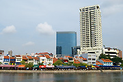Singapore, Singapore - August 05, 2008: Colorful buildings in Clarke Quay with modern architecture at the background in Singapore, Singapore.