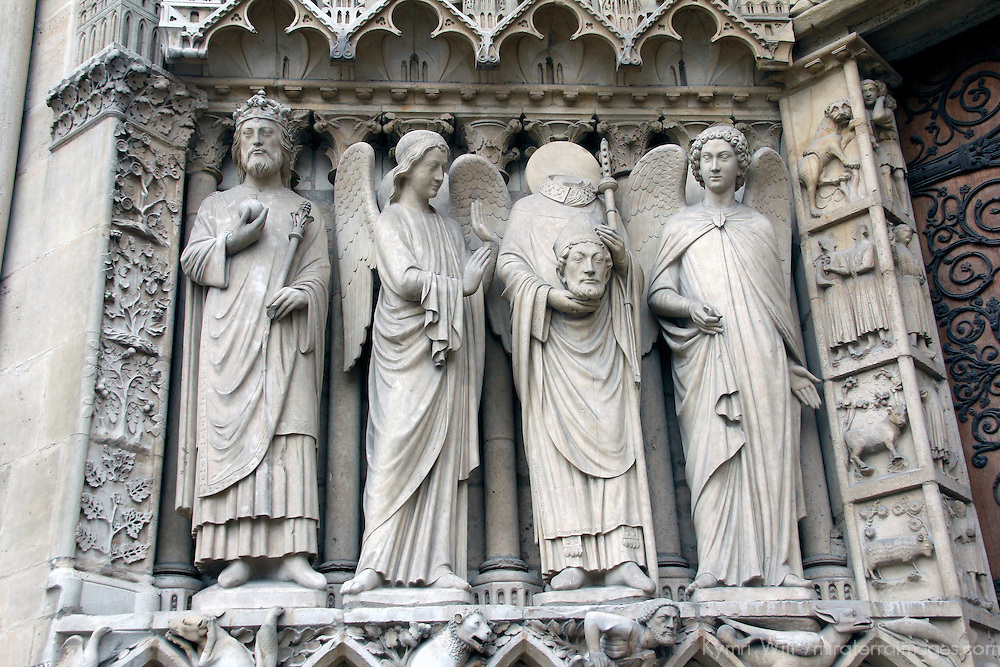 Europe, France, Paris. Notre-Dame Cathedral Saints Statues, including John the Baptist.