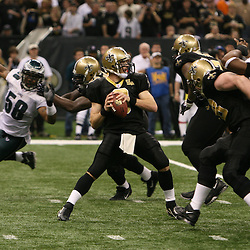 13 January 2007: New Orleans Saints quarterback Drew Brees (9) looks to pass during a 27-24 win by the New Orleans Saints over the Philadelphia Eagles in the NFC Divisional round playoff game at the Louisiana Superdome in New Orleans, LA. The win advanced the New Orleans Saints to the NFC Championship game for the first time in the franchise's history.