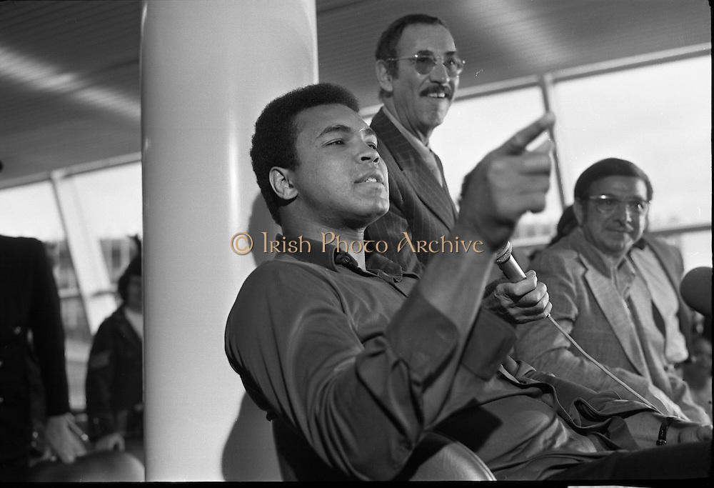 Muhammad Ali In Dublin..1972..11.07.1972..07.11.1972..11th July 1972..Prior to his fight against Al 'Blue' Lewis at Croke Park ,Dublin, former World Heavyweight Champion,Muhammad Ali arrives at Dublin Airport..The fight was part of his build up for for a championship fight against the current World Champion, 'Smokin'  Joe Frazier. Ali had been stripped of the title partly due to his refusal to join the American military during The Vietnam War,which he had opposed...Muhammad Ali stresses a point during the press conference.