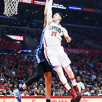 23 December 2016: LA Clippers guard Austin Rivers (25) is blocked by Dallas Mavericks center Salah Mejri (50) during the Dallas Mavericks 90-88 victory over the LA Clippers, at the Staples Center, Los Angeles, California, USA.