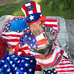 "Luther Hill, AKA ""Captain 4th of July"", from Boise, relaxes on an American flag themed blanket during Fourth of July festivities held in Ann Morrison park in Boise, Idaho. Saturday July 4, 2015"