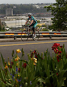 A cyclist winds his way up through downtown Portland and up into the west hills.