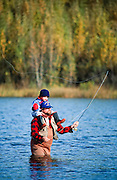 Alaska. A fisherman and his son flyfishing in one of the many rivers.