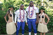 KO OLINA - FEBRUARY 11:  NFC Detroit Lions 2005 NFL Pro Bowl All-Stars (players left to right: Dre' Bly #32, Shaun Rogers #92) pose with Hawaiian Hula girls for their 2005 NFL Pro Bowl team photo on February 11, 2005 in Ko Olina, Hawaii. ©Paul Anthony Spinelli