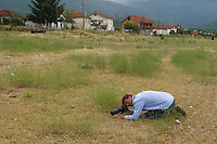 Nature photographer David Maitland photographing insects in <br /> Stenje region, Lake Macro Prespa (850m) <br /> Galicica National Park, Macedonia, June 2009<br /> Mission: Macedonia, Lake Macro Prespa /  Lake Ohrid, Transnational Park<br /> David Maitland / Wild Wonders of Europe