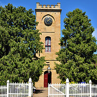 St Luke Anglican Church in Richmond, Australia<br /> Convicts from the nearby gaol toiled for two years hauling sandstone blocks from Butcher's Hill and lifting them into place in order to realize the Georgian Gothic façade of St Luke Anglican Church. Its square, embattled tower has changed little since it was designed by John Lee Archer and finished in 1836. The clock predates the church. It was crafted by Thwaites & Reed in London - the world's oldest clock manufacturer - in 1828. After being used at St David's Cathedral in Hobart, it was installed at St Luke the Physician in 1922. Inside, the stain-glass windows were added in 1864. Four years later, the parishioners began enjoying an organ from Bevington & Sons, also London based. It was replaced by an organ from an Australian company in 1984.