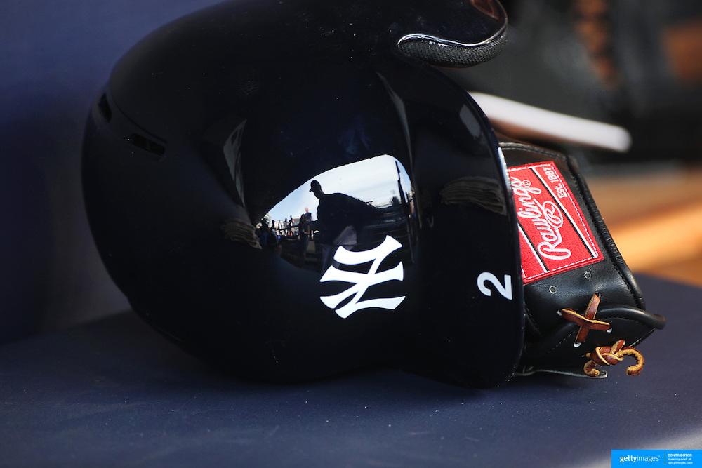 Derek Jeter, New York Yankees, reflected in his batting helmet in the dugout before the New York Yankees Vs New York Yankees Vs Cincinnati Reds baseball game at Yankee Stadium, The Bronx, New York. 12th May 2014. Photo Tim Clayton