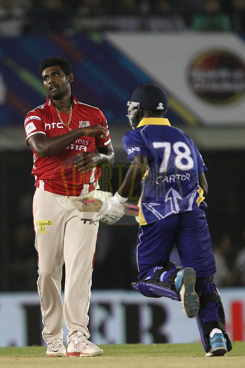 Thisara PERERA of the Kings XI Punjab reacts after a delivery during match 5 of the Oppo Champions League Twenty20 between the Kings XI Punjab and the Barbados Tridents held at the Punjab Cricket Association Stadium, Mohali, India on the 20th September 2014<br /> <br /> Photo by:  Ron Gaunt / Sportzpics/ CLT20<br /> <br /> <br /> Image use is subject to the terms and conditions as laid out by the BCCI/ CLT20.  The terms and conditions can be downloaded here:<br /> <br /> http://sportzpics.photoshelter.com/gallery/CLT20-Image-Terms-and-Conditions-2014/G0000IfNJn535VPU/C0000QhhKadWcjYs