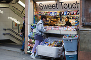 A teenager buys cigarettes ans chocolate from sweet choice, an Oxford street kiosk.