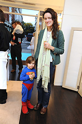 POPPY FRASER and her son LORCAN HUGHES at a party to celebrate the opening of Pincess Marie-Chantal of Greece's store 'Marie-Chantal' 133A Sloane Street, London on 14th October 2008.