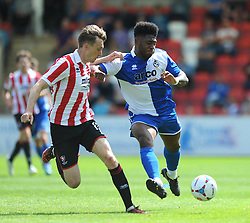 Ellis Harrison of Bristol Rovers is challenged by Daniel Parslow of Cheltenham Town  - Mandatory by-line: Dougie Allward/JMP - 25/07/2015 - SPORT - FOOTBALL - Cheltenham Town,England - Whaddon Road - Cheltenham Town v Bristol Rovers - Pre-Season Friendly