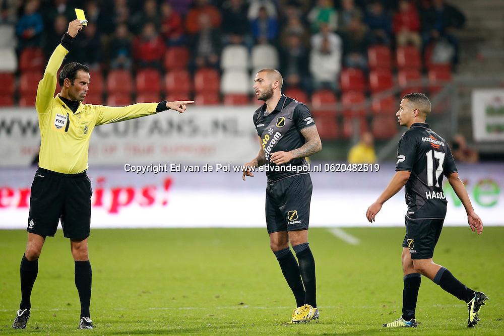UTRECHT, 19-10-2013, eredivisie, FC Utrecht - NAC Breda, Galgenwaard Stadion, 4-2, scheidsrechter Bas Nijhuis (l) geeft de gele kaart aan Speler van NAC Anouar Hadouir (r).