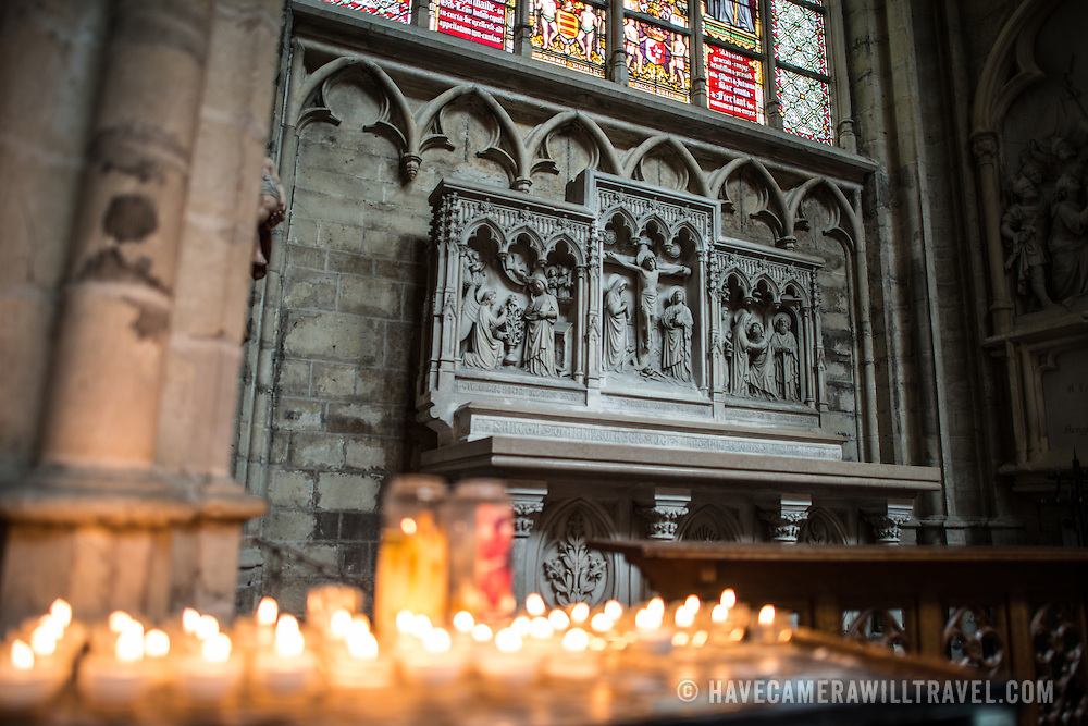 Votives and a small chapel at the Cathedral of St. Michael and St. Gudula (in French, Co-Cathédrale collégiale des Ss-Michel et Gudule). A church was founded on this site in the 11th century but the current building dates to the 13th to 15th centuries. The Roman Catholic cathedral is the venue for many state functions such as coronations, royal weddings, and state funerals. It has two patron saints, St Michael and St Gudula, both of whom are also the patron saints of Brussels.