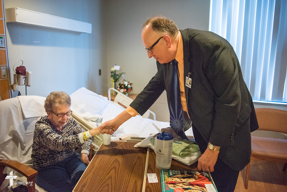 The Rev. Doug Nicely, chaplain at Memorial Hospital in Belleville, Ill., visits and prays with patient Audrey Justus on Monday, Jan. 12, 2015. LCMS Communications/Erik M. Lunsford