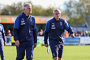 AFC Wimbledon temporary manager coach Glyn Hodges and AFC Wimbledon coach Vaughan Ryan walking off the pitch during the EFL Sky Bet League 1 match between AFC Wimbledon and Portsmouth at the Cherry Red Records Stadium, Kingston, England on 19 October 2019.