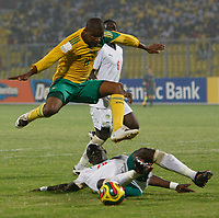 Photo: Steve Bond/Richard Lane Photography.<br />Senegal v South Africa. Africa Cup of Nations. 31/01/2008. Elrio Van Heerden (L) vaults the challange of Abdouleye Feye (ground)