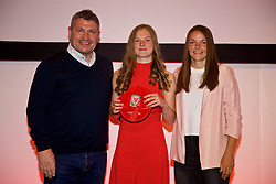 NEWPORT, WALES - Saturday, May 19, 2018: Megan Lewis is presented with her Under-16's cap by Osian Roberts (left) and Lauren Dykes (right) during the Football Association of Wales Under-16's Caps Presentation at the Celtic Manor Resort. (Pic by David Rawcliffe/Propaganda)