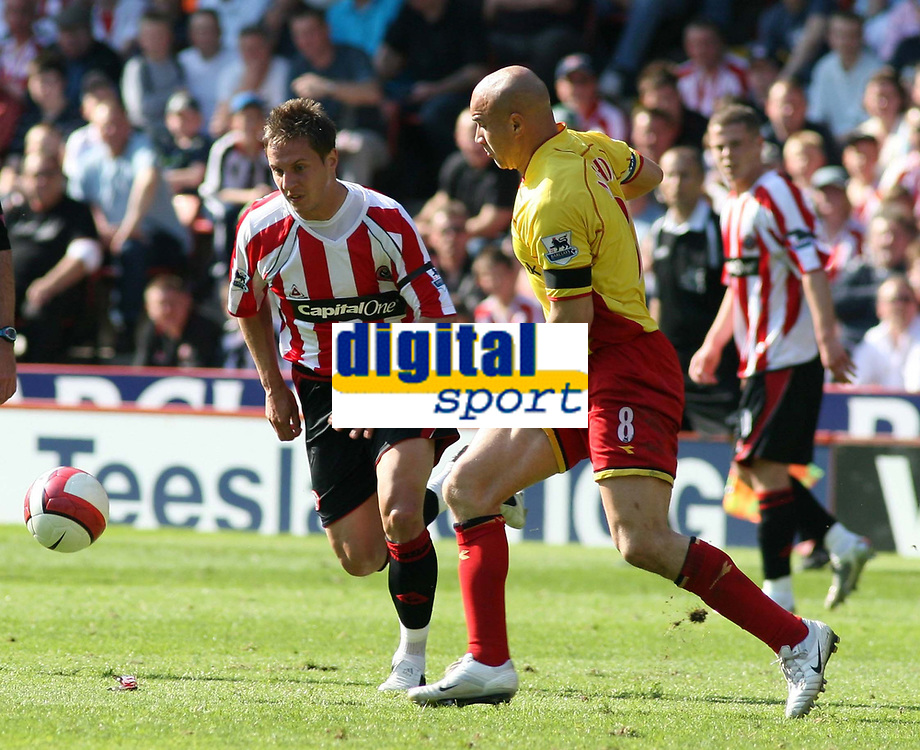 Photo: Mark Stephenson.<br /> Sheffield United v Watford. The Barclays Premiership. 28/04/2007.Sheffield's Phil  Jagielka trys to go around Watford's Gavin Mahon