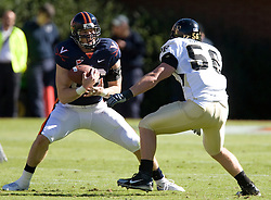 Virginia tight end Tom Santi (86) comes down with a pass from Virginia quarterback Jameel Sewell (10) as he's defended by Wake Forest linebacker Hunter Haynes (56).  The #23 Virginia Cavaliers defeated the #24 Wake Forest Demon Deacons 17-16 at Scott Stadium in Charlottesville, VA on November 3, 2007.
