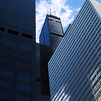 The Willis Tower, center, stands above other tall buildings in Chicago, Illinois.