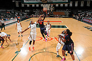 February 20, 2014: Brittney Sykes #20 of Syracuse shoots past Keyona Hayes #20 of Miami during the NCAA basketball game between the Miami Hurricanes and the Syracuse Orange at the Bank United Center in Coral Gables, FL. The Orange defeated the Hurricanes 69-48.