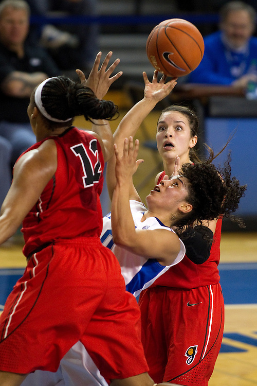 UK guard Jennifer O'Neill, right, is fouled while going to the basket with pressure from Georgia forward Jasmine Hassell. The University of Kentucky Women's Basketball team hosted Georgia, Sunday, Feb. 03, 2013 at Memorial Coliseum in Lexington.