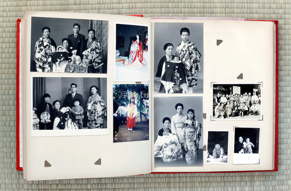 open page of an old family photo album Japan Asia