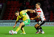 Doncaster - Tuesday September 14th, 2010:  Doncaster Rovers's Billy Sharp and Norwich City's Wesley Hoolahan in action during the NPower Championship match at Keepmoat Stadium, Doncaster. (Pic by Dave Howarth/Focus Images)