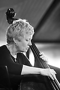 A black and white image of bassist Alison Rayner from the Deirdre Cartwright group during a performance in 2008 in the frontroom of the Southbank center in London.