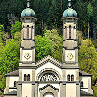 St. John the Baptist Church Among Lush Forest in Todtnau, Germany <br /> Nestled in the southern part of Germany's Black Forest is Todtnau, a small town of less than 5,000 that enjoys the river Wiese and panoramic scenes of lush, green trees.  Judging from the view from St. John the Baptist Church, the town hosts plenty of skiers in the winter on the region's highest mountains.  It also offers the country's longest toboggan ride called the Hasenhorn roller coaster.  The track is almost two miles long.