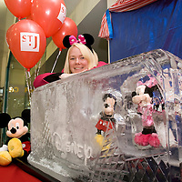 FREE TO USE PHOTOGRAPH......Tricia Fox from the St John's Centre in Perth pictured with a giant block of ice containing Disney charachters which has gone on display in the centre for a competition in which members of the public guess how long it waill take the ice to melt with a fabulous prize on offer for the winner.<br /> For further info contact Tricia Fox on 01738 658187<br /> Picture by Graeme Hart.<br /> Copyright Perthshire Picture Agency<br /> Tel: 01738 623350  Mobile: 07990 594431