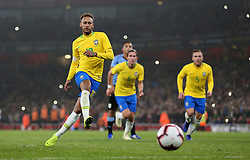 Brazil's Neymar scores his sides first goal
