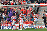 Sam Winnall of Barnsley FC scores for Barnsley to equalise 1-1 during the Sky Bet League 1 match between Doncaster Rovers and Barnsley at the Keepmoat Stadium, Doncaster, England on 3 October 2015. Photo by Ian Lyall.