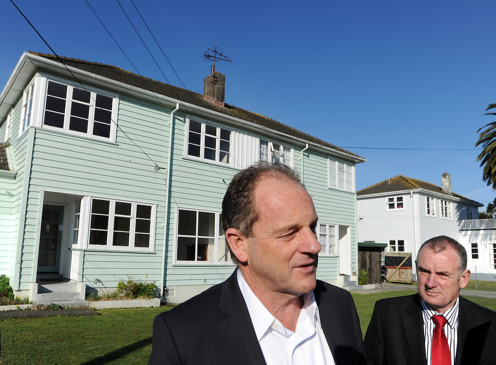 Labour leader David Shearer, left, with fellow MP Trevor Mallard visit an empty state house in Farmer Cresent, to point out the increase of empty state houses available for rent, Lower Hutt, New Zealand, Thursday, August 01, 2013. Credit:SNPA / Ross Setford