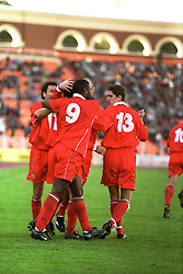 MINSK, BELARUS - Saturday, September 4, 1999: Wales's Dean Saunders, Ryan Giggs, Nathan Blake and Carl Robinson celebrate the winning goal during the UEFA Euro 2000 Qualifying Group One match against Belarus at the Dinamo Stadium. (Mandatory credit: David Rawcliffe/Propaganda)