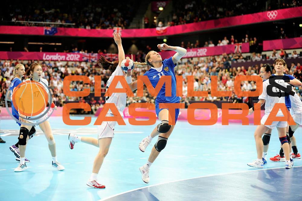 DESCRIZIONE : Handball Jeux Olympiques Londres Quart de Finale<br /> GIOCATORE : Khmyrova Tatiana RUS <br /> SQUADRA : Russie Femme<br /> EVENTO :  Handball Jeux Olympiques<br /> GARA : Coree Russie<br /> DATA : 07 08 2012<br /> CATEGORIA : handball Jeux Olympiques<br /> SPORT : HANDBALL<br /> AUTORE : JF Molliere <br /> Galleria : France JEUX OLYMPIQUES 2012 Action<br /> Fotonotizia : France Handball Femme Jeux Olympiques Londres Quart de Finale Copper Box<br /> Predefinita :