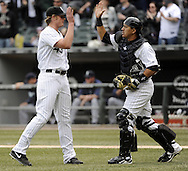 CHICAGO - APRIL 06:  Addison Reed #43 and Hector Gimenez #38 of the Chicago White Sox celebrate after the game against the Seattle Mariners on April 06, 2013 at U.S. Cellular Field in Chicago, Illinois.  The White Sox defeated the Mariners 4-3.  (Photo by Ron Vesely)   Subject:  Addison Reed; Hector Gimenez