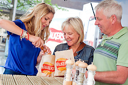 Walkers Fresh Hot Crisp Tour comes to Barkers Pool Sheffield as Masterchef winner Lisa Faulkner Shows Esther and Alan Sanders of Rotherham the three simple things that go into making a bag of crisps..10th September2011 Image © Paul David Drabble