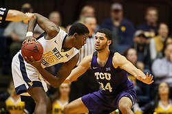 Feb 12, 2018; Morgantown, WV, USA; TCU Horned Frogs guard Kenrich Williams (34) guards West Virginia Mountaineers forward Lamont West (15) during the first half at WVU Coliseum. Mandatory Credit: Ben Queen-USA TODAY Sports