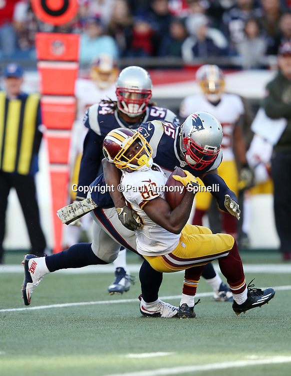 Washington Redskins wide receiver Jamison Crowder (80) gets gang tackled by New England Patriots middle linebacker Jonathan Freeny (55) as New England Patriots outside linebacker Dont'a Hightower (54) close in to assist after Crowder catches a third quarter pass reception during the 2015 week 9 regular season NFL football game against the New England Patriots on Sunday, Nov. 8, 2015 in Foxborough, Mass. The Patriots won the game 27-10. (©Paul Anthony Spinelli)