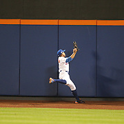 NEW YORK, NEW YORK - October 5:  Curtis Granderson #3 of the New York Mets makes a spectacular catch at center field off Brandon Belt #9 of the San Francisco Giants in the sixth inning during the San Francisco Giants Vs New York Mets National League Wild Card game at Citi Field on October 5, 2016 in New York City. (Photo by Tim Clayton/Corbis via Getty Images)