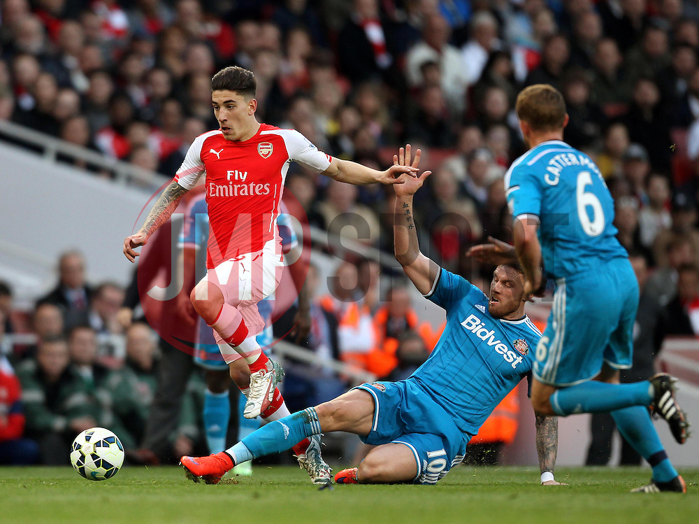 Arsenal's Héctor Bellerin goes past the tackle of Sunderland's Connor Wickham - Photo mandatory by-line: Robbie Stephenson/JMP - Mobile: 07966 386802 - 20/05/2015 - SPORT - Football - London - Emirates Stadium - Arsenal v Sunderland - Barclays Premier League